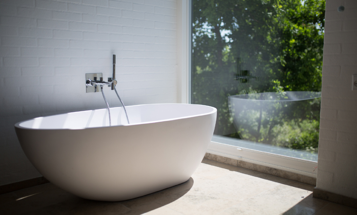 Bathtub facing Window with Outdoor View