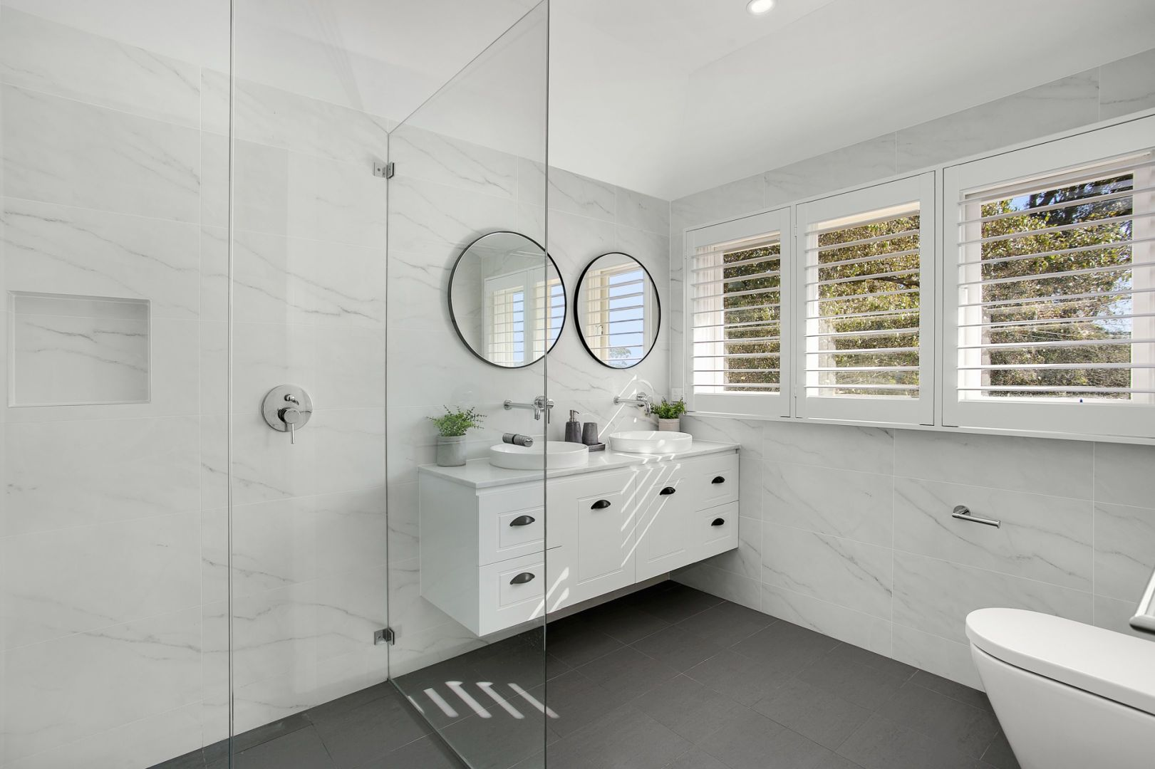 Marble Bathroom with Glass and Windows