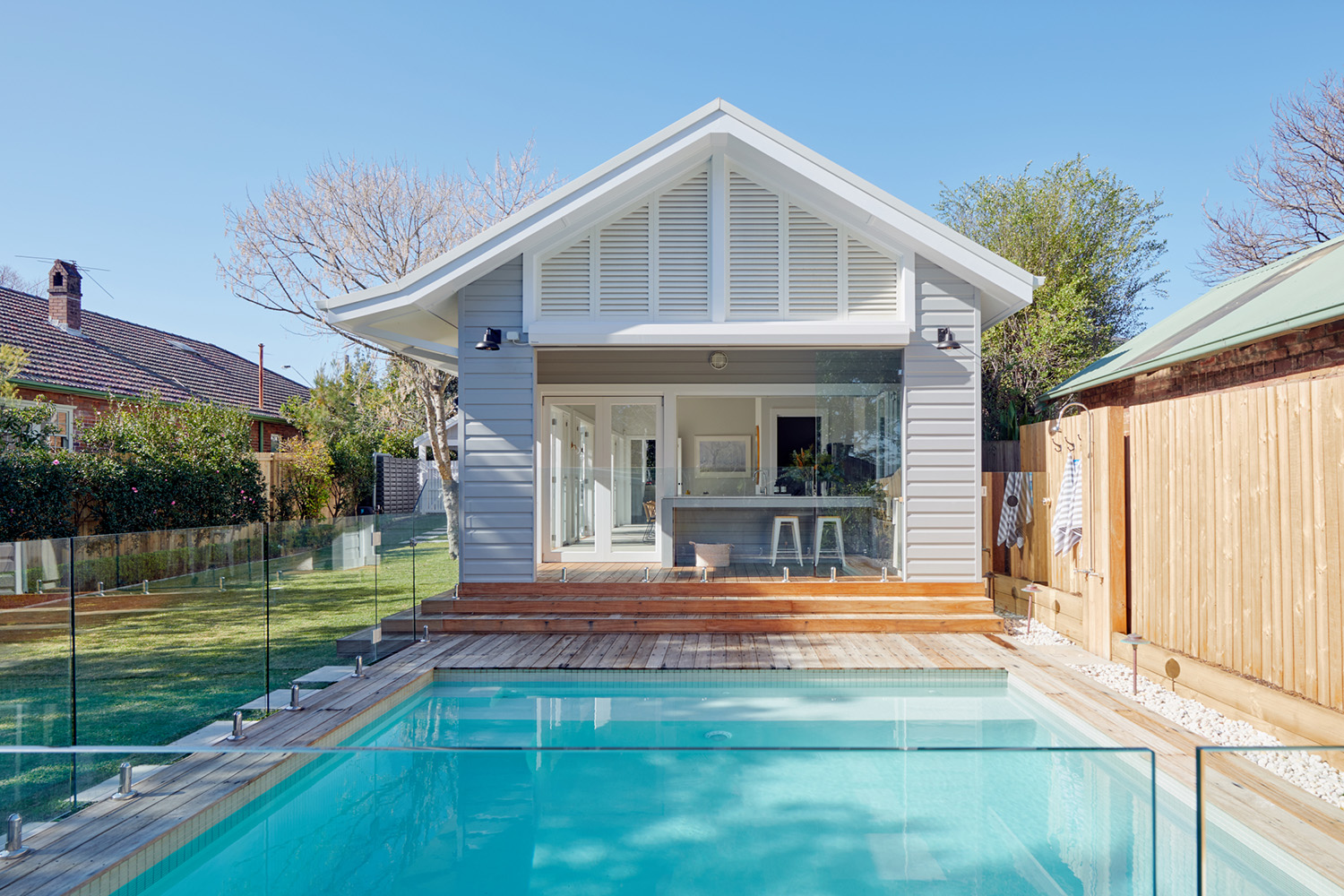 Home Swimming Pool with Timber Deck and Weatherboard