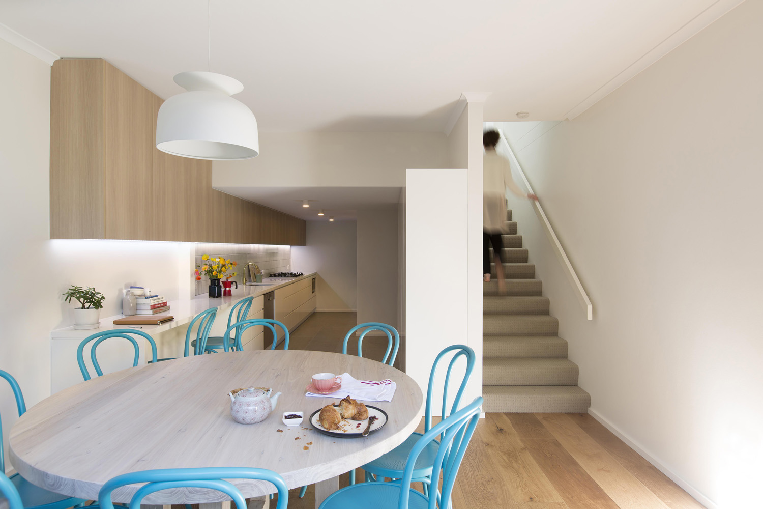 Simple Dinning Room with Stairs to Second Floor