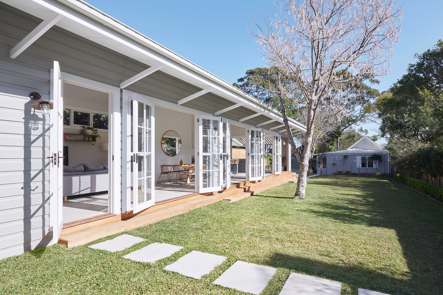 Outdoor Indoor Home with Side Grassed Area and Grey Weatherboard