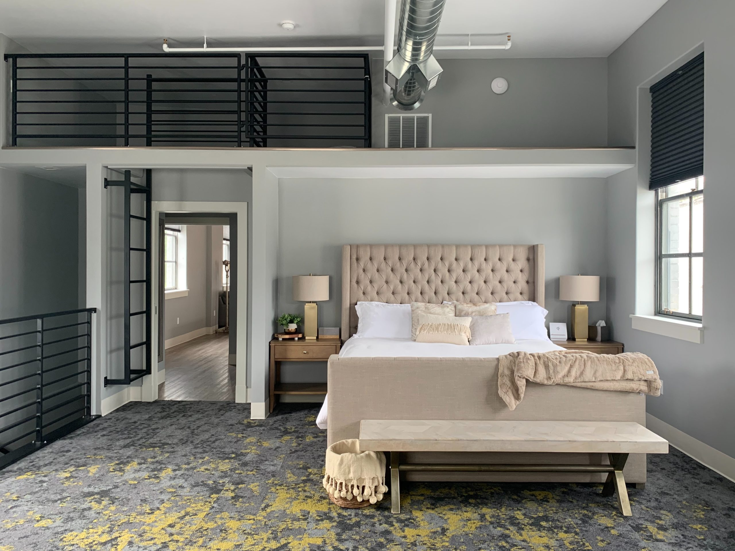 Modern Bedroom with Grey Walls and Door